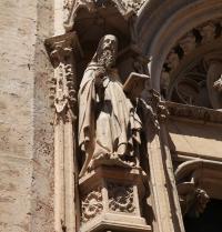 Sculpture of Ramon Llull in the main portal, gothic (1391). Sant Miquel Church. Palma. IRU, SL.